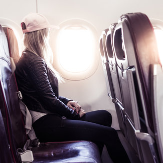 Young woman traveling by airplane picjumbo com